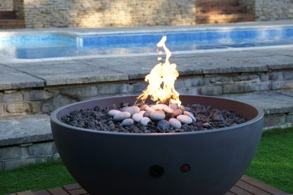 Hemi fire pit shown, lit, in Sussex