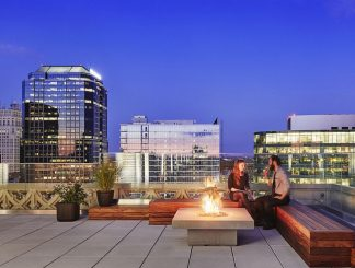 Solus Elevated Halo firepit shown on rooftop deck in Baltimore