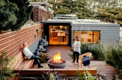 "Solus hemi 36"" fire pit behind modern home, as featured in Dwell magazine"