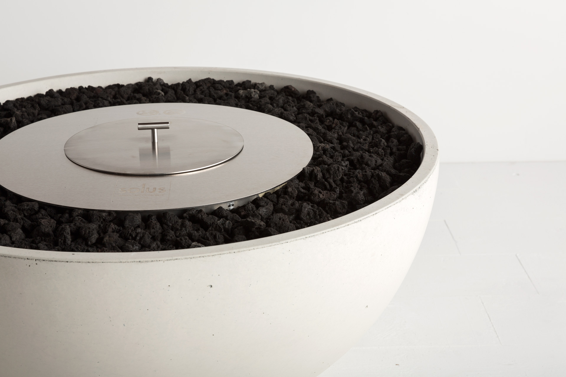 Solus hemi gas fire pit shown with ethanol burner and lid