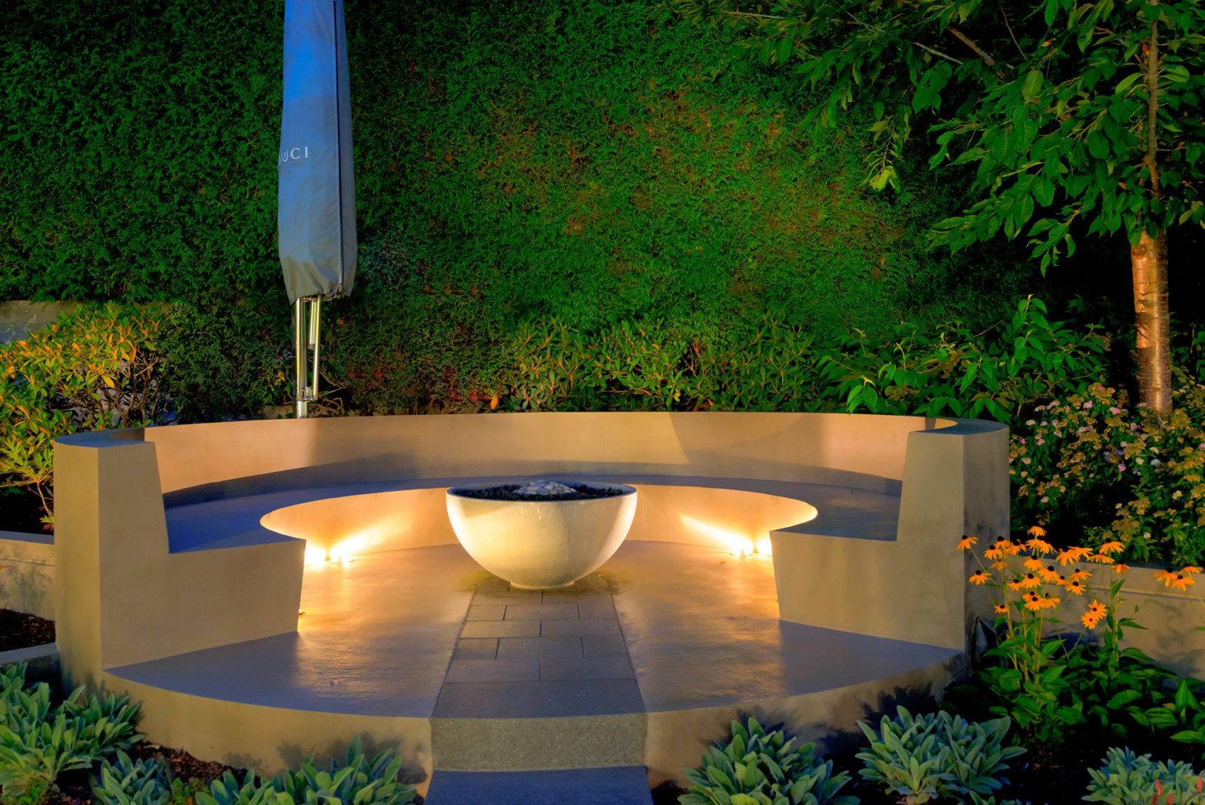 Solus Hemi 36 with curved seating lit beautifully at night