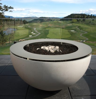 Solus Décor Hemi Gas Firebowl Firepit. With metal drinks ring. Shown on the terrace at Predator Ridge Resort Canada. The metal table top turns this firepit into a modern table when not lit.